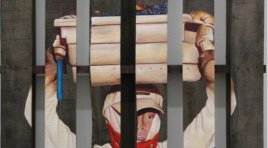 An individual with a red scarf and baseball hall appears behind five vertical lines holding a large item overhead.